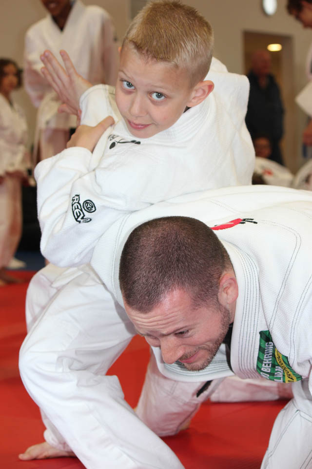 BJJ youth with instructor
