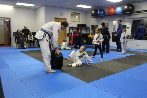 Instructor holdng a pad for the student to practice a technique