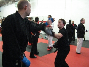 Kyoshi Mike working with a student on a technique